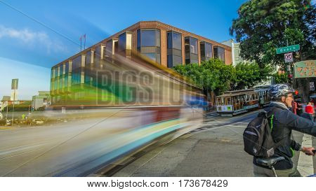 San Francisco, California, United States - August 14, 2016:Cable Car of the famous Powell-Hyde lines crossing in motion blur the Beach and Hyde Streets crossroad near Fishermen's Wharf.Urban cityscape