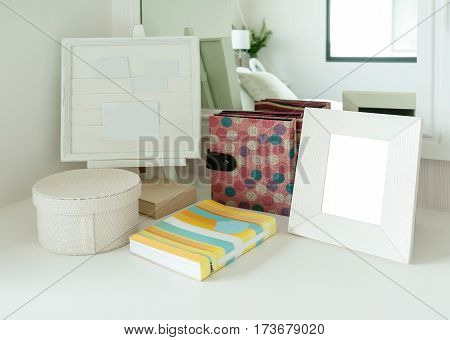 Contemporary Bedroom Decoration With Picture Frame And Book On A Dresser