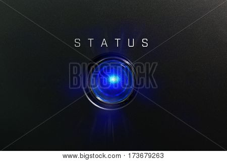 Status indicator or lamp. Blue glowing warning lamp or button black panel with the words,