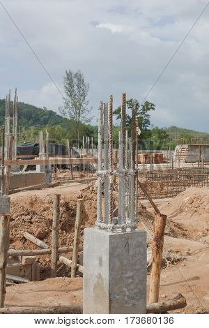 Construction work progress with concrete column and rebar