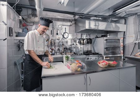 Young Chef Cutting Parsley Kitchen