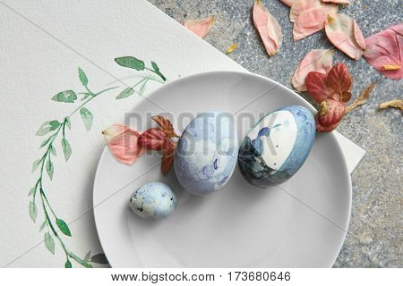 painted eggs on a plate