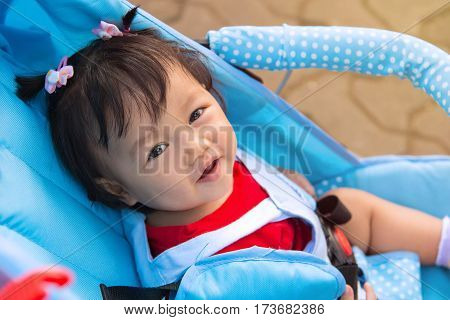 Baby Girl Smile Sitting In Stroller, Childhood And People Concept