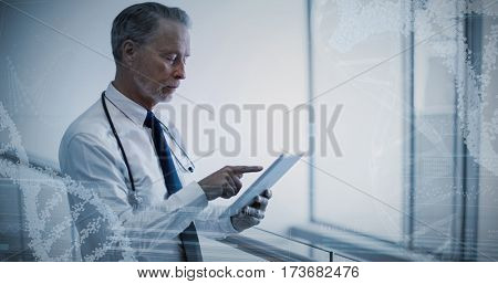Panoramic view of helix pattern information on device screen against male surgeon using digital tablet