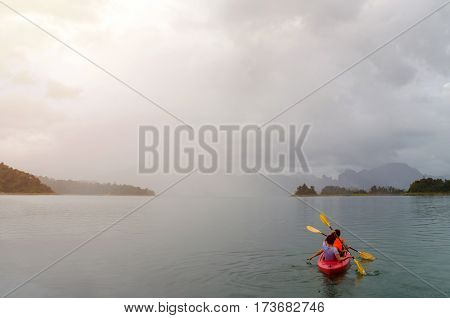 Floating red Canoe in Ratchaprapha Dam at Khao Sok National Park Thailand.