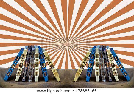 Magnetic tape cassette on sun beam light background