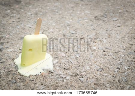 Ice cream on the ground. selective focus. soft focus.