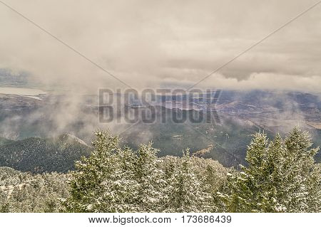 Snow-covered evergreens mountain ridges valleys lakes and fields...this is Montana