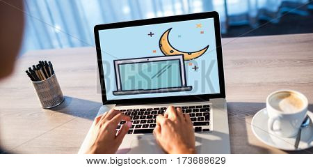 Print against woman typing on laptop at table