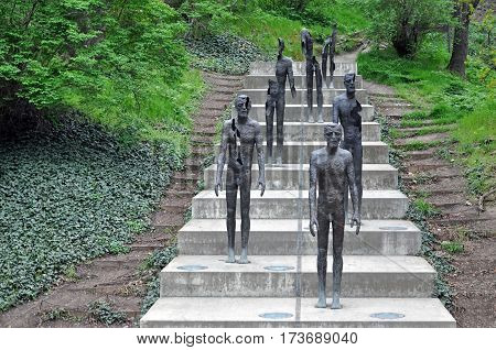 Prague, Czech Republic - April 11, 2016: Memorial to the Victims of Communism in Prague. Metal sculptures of people on the stairs.