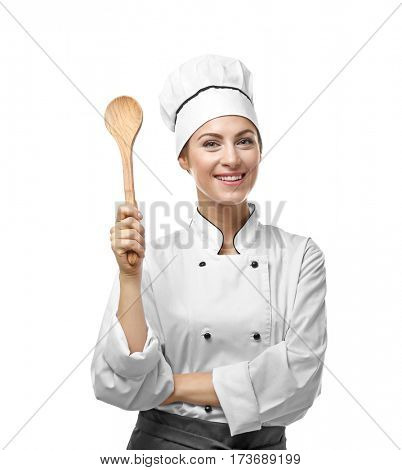 Portrait of female chef with wooden spoon isolated on white