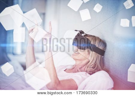 Digitally generated grey cubes floating against woman gesturing while using virtual reality simulator 3D