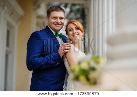 Wedding Couple In Love Background Large Columns Of Antique House.