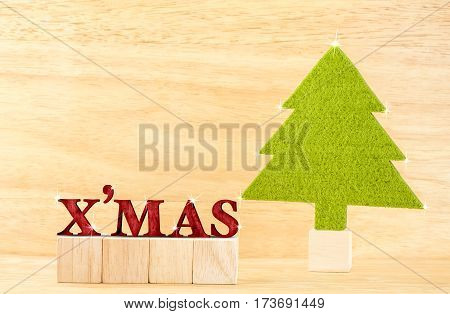 Red X'mas Word With Green Christmas Tree In Wooden Room,holiday Concept