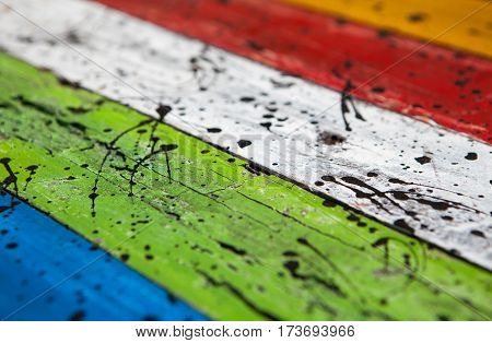 Patterned and textures background of brightly colored panels of weathered painted wooden boards