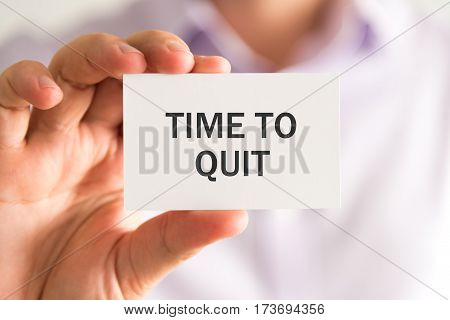Businessman Holding A Card With Time To Quit Message