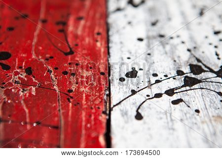 Patterned and textures background of brightly colored panels of weathered painted wooden boards. the flag of Indonesia