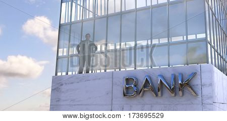 Businessman standing with hands on hips against low angle view of facade of office building