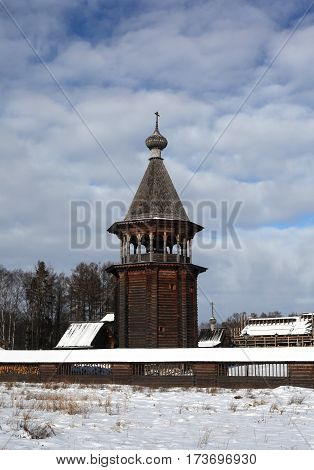 Russian wooden bell tower. Traditional architecture in the culture of Russia. Orthodox Christian Church of the Intercession of the Holy Virgin. St. Petersburg.