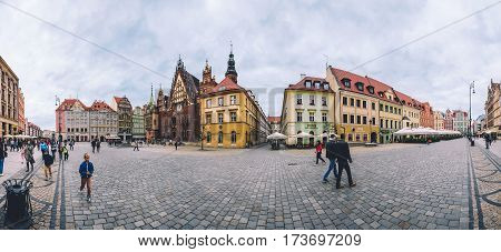 Wroclaw, Silesia, Poland - September, 20th, 2016. Wroclaw Old Town panorama with Market Square Rynek, Wroclaw Town Hall, traditional colorful houses, tourist walkway and pavement square.