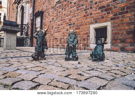 Wroclaw, Poland - September, 19th, 2016. Disabled dwarfs statues at Wroclaw Market square near Old Town hall. Bronze gnome sculptures are the main tourist attraction and symbol of the city.