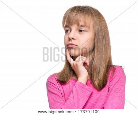 Casual thinking girl - caucasian female model. Close-up emotional portrait of child. Thoughtful kid, isolated on white background. Beautiful smart serious ponder children.