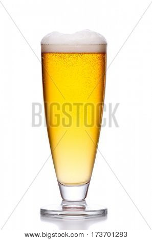glass of cold light beer with foam on white background
