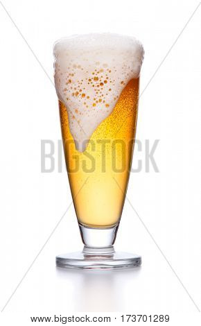 glass of light beer foam. lager beer in a glass beaker with fresh bubbling foam isolate on white