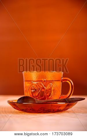 Pour hot water into a cup of coffee