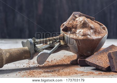 Scoop Of Chocolate Ice Cream On Rustic Wooden Background.