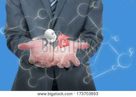 Midsection of businessman holding invisible object against blue background 3D