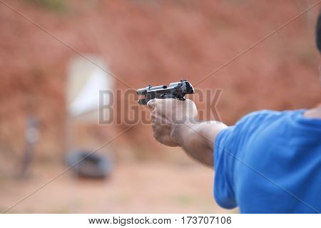Man holding a pistol in his hands ready to shoot