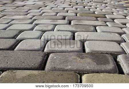 Background of cobble stone road making from cement blocks .