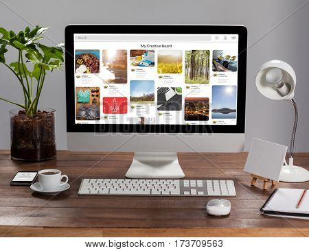 Computer with personal organizer and belongings against composite image of website page