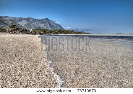 Shallow shelving of this beach provides an excellent image of the incoming tide. Hermanus, South Africa