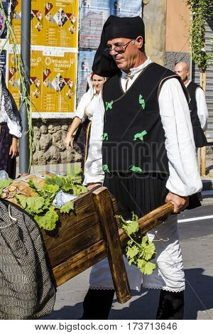 SELARGIUS, ITALY - September 11, 2016: Former marriage Selargino - Sardinia - portrait of a man in traditional Sardinian costume