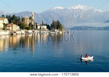 People On A Rowing Boat At The Coast Of Lake Como