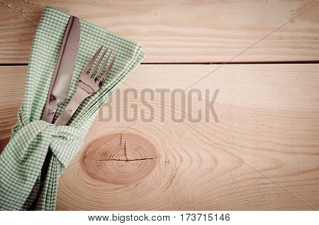 Dining Table Setting. Cutlery with Empty Tag and Present on Linen Napkin on Rustic Wooden Background. Copy Space. Selective Focus.