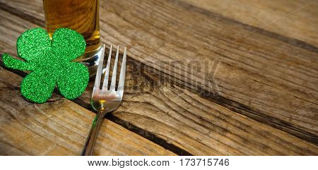 Green shamrocks st patrick day and fork