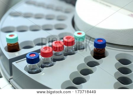Quality Control Laboratory Medicine. Chromatograph Operation. Bottles Check On The Quality Of The Su