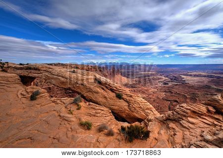 Sandstone arch and canyon under blue sky. Mesa Arch. Canyonlands National Park. Moab. Cedar City. Utah. United States.