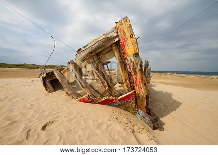 Wrecked boat on the sand at Braunton Burrows, Devon