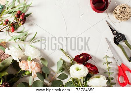 Top view bouquet preparation with copy space. Small business concept