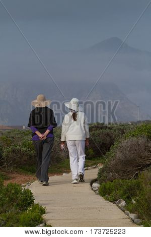 Two ladies walking the coastal path at Hermanus
