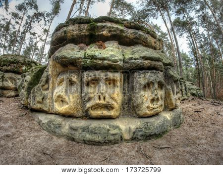 Scary Stone Heads - rock sculptures of giant heads carved into the sandstone cliffs