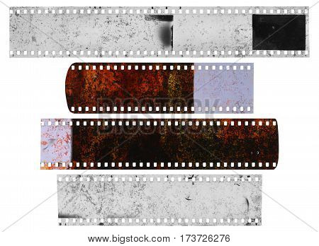 Dirty messy and damaged strip of celluloid film on white background
