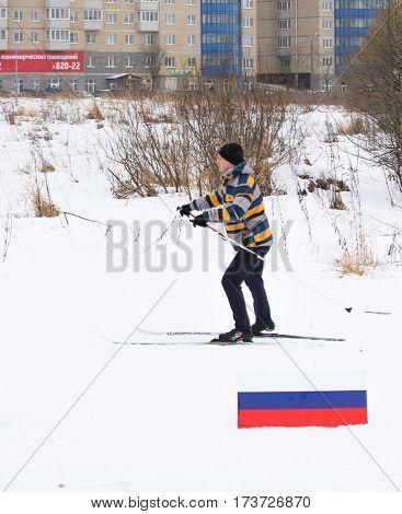 Kirishi, Russia - 11 February, Man running on the track, 11 February, 2017. Mass ski race Russian Ski Track.
