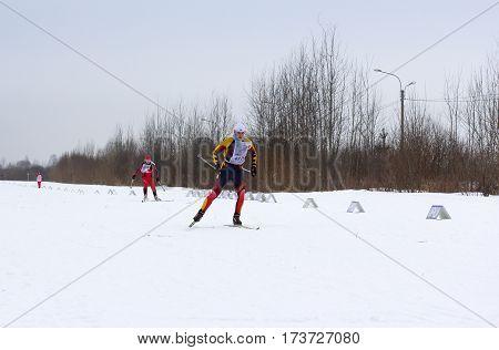 Kirishi, Russia - 11 February, Man running on skis, 11 February, 2017. Mass ski race Russian Ski Track.