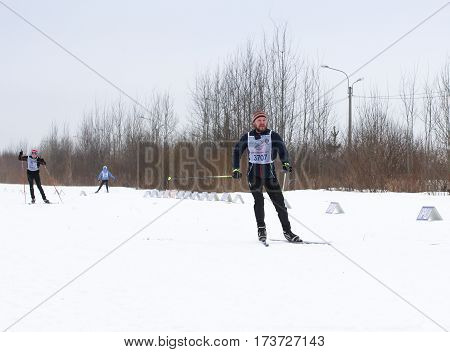 Kirishi, Russia - 11 February, People are running around on skis, 11 February, 2017. Mass ski race Russian Ski Track.