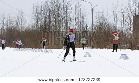 Kirishi, Russia - 11 February, People in winter on skis, 11 February, 2017. Mass ski race Russian Ski Track.